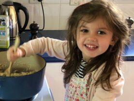 Matilda helps dad in the kitchen.